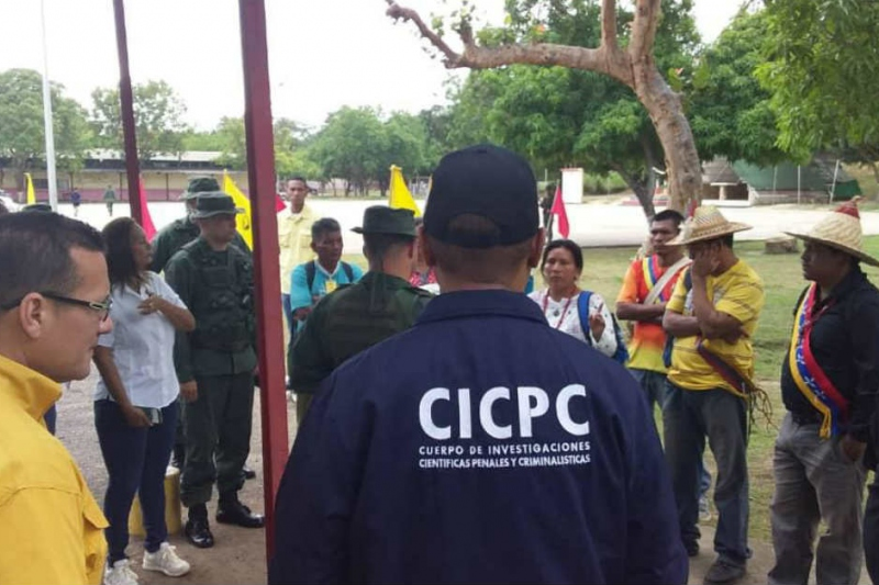 Local police officials and soldiers address indigenous citizens of the Sierra de Perija region of Venezuela